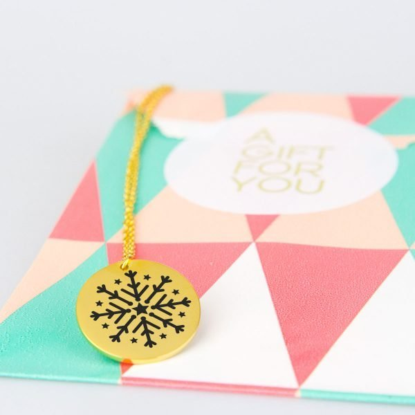 gold snowflake and star necklace